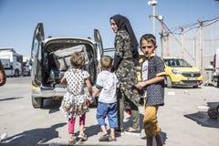 Syrian refugees entering Turkey Stock Photo