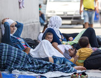 Syrian refugees at Keleti train station. Refugees from Syria are gathered at Keleti train station in Hungary, Sunday 30 august 2015. Thousands of syrian refugees stock image
