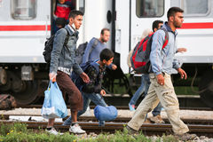 Syrian refugees walking on railway Royalty Free Stock Image