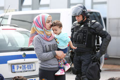 Syrian woman with child on border Stock Image