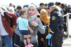 Syrian woman with child on slovenian border Stock Image