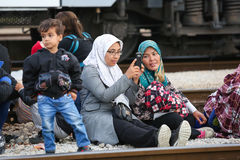 Syrian woman photographing on railway Royalty Free Stock Photos