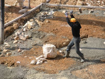 Syrian Worker in Lebanon Splitting Rocks at a Construction Site Stock Photo