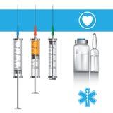 Syringe and ampules Royalty Free Stock Photo