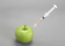 Syringe In Apple Royalty Free Stock Photography