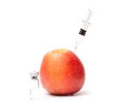 Syringe in apple and bottle Stock Photo