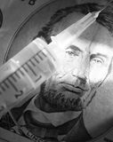 Syringe and bill. Syringe and five dollars bill as a background Royalty Free Stock Image