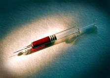 Syringe with blood Stock Image