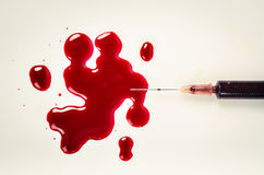 Syringe with blood Royalty Free Stock Photography