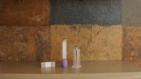Syringe, blood specimen tube and adhesive bandage Stock Photo
