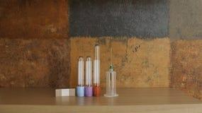 Syringe, blood specimen tubes and adhesive bandage Stock Photo