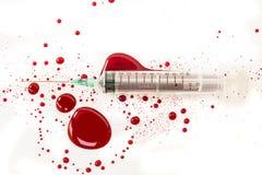Syringe with blood splash Stock Photo