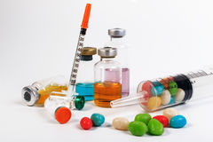 A syringe and candy bottle. Royalty Free Stock Image