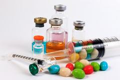 A syringe and candy bottle. Stock Photo