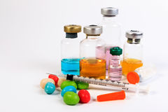 A syringe and candy bottle. Stock Images