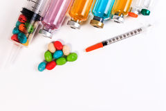 A syringe and candy bottle. Royalty Free Stock Photo