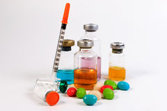 A syringe and candy bottle isolate on white background. Stock Photography