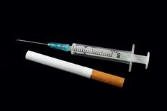 Syringe and cigarette Royalty Free Stock Photography