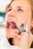 Syringe - dentist gives anesthesia