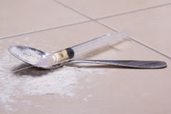 Syringe with drug substance, heroin powder and spoon Stock Photography