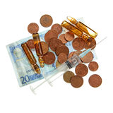 Syringe, drugs ampules. coins and twenty euro banknote Royalty Free Stock Photo