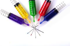 Syringe filled with colors. Stock Photo
