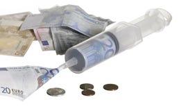 Syringe filled with money Royalty Free Stock Image