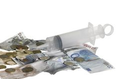 Syringe filled with money Royalty Free Stock Photography