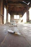 Syringe on floor Stock Photo