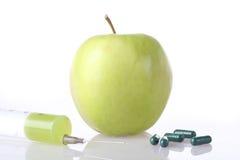 Syringe, fruit, pills Stock Photos