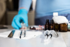 Syringe with glass vials and medications pills Stock Photos