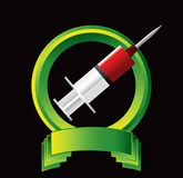 Syringe in green crest Royalty Free Stock Photos