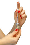 Syringe and hand Stock Photography