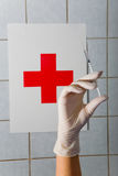 Syringe in hand a nurse. Royalty Free Stock Image