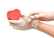 Syringe and heart Stock Image