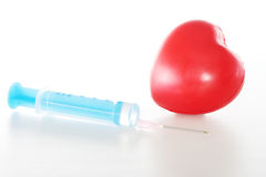 Syringe and heart Royalty Free Stock Photography
