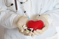 Syringe in heart doctor hand Stock Photos