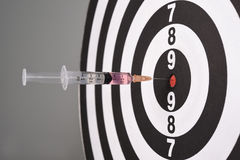 Syringe In Dart Board Royalty Free Stock Images