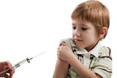 Syringe injecting child. Medicine healthcare syringe injecting scared child royalty free stock images
