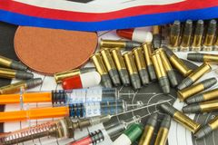 Syringe and medals. Doping in shooting sport. Abuse of anabolic steroids for sports. Deception in biathlon. Royalty Free Stock Photos