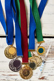 Syringe and medals on wood. Royalty Free Stock Photo