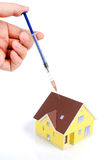 Syringe and model house Royalty Free Stock Photos