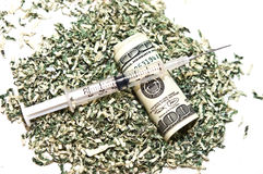 Syringe and Money Royalty Free Stock Image