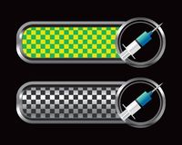 Syringe on multicolored checkered tabs Royalty Free Stock Photography