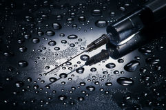 Syringe and needle. Water drops background,dramatic lighting Royalty Free Stock Photography
