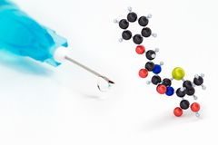 Syringe and Penicillin V composite Royalty Free Stock Photos