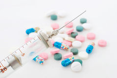 Syringe and pills Stock Images