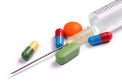 Syringe and Pills Stock Photo