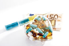 Syringe, pills and Euro note Royalty Free Stock Photo