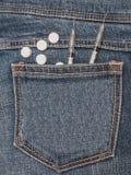 Syringe and pills on jean pocket Stock Image